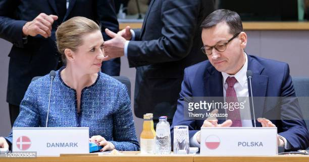 Danish Prime Minister Mette Frederiksen talks with the Polish Prime Minister Mateusz Morawiecki during a special European Council summit on February...