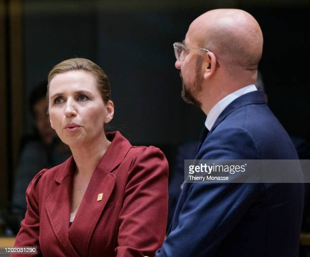 Danish Prime Minister Mette Frederiksen talks with the President of the European Council Charles Michel during a special European Council summit on...
