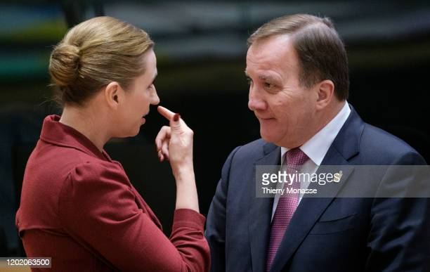 Danish Prime Minister Mette Frederiksen talks with the Swedish Prime Minister Kjell Stefan Lofven during a special European Council summit on...