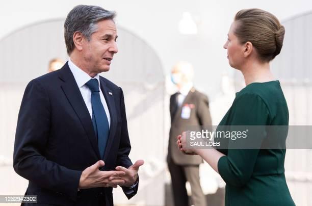 Danish Prime Minister Mette Frederiksen talks with US Secretary of State Antony Blinken as he arrives for meetings at Marienborg, the official...