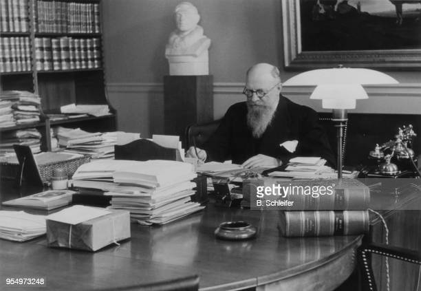 Danish Prime Minister Thorvald Stauning at work in his office, circa 1940.