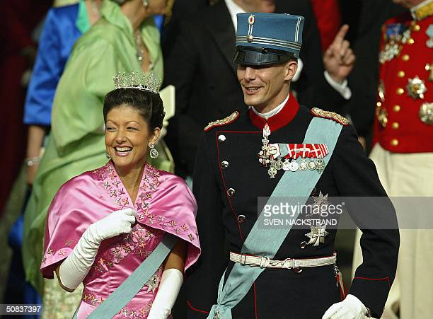 Danish Prince Joachim and his wife Princess Alexandra share a laugh as they leave the Copenhagen Cathedral in Copenhagen 14 May 2004 after the...