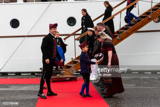 Danish Prince Vincent shake hands with officials during the Danish Crown Prince family arrival on their official visit to the Faroe Islands at the...