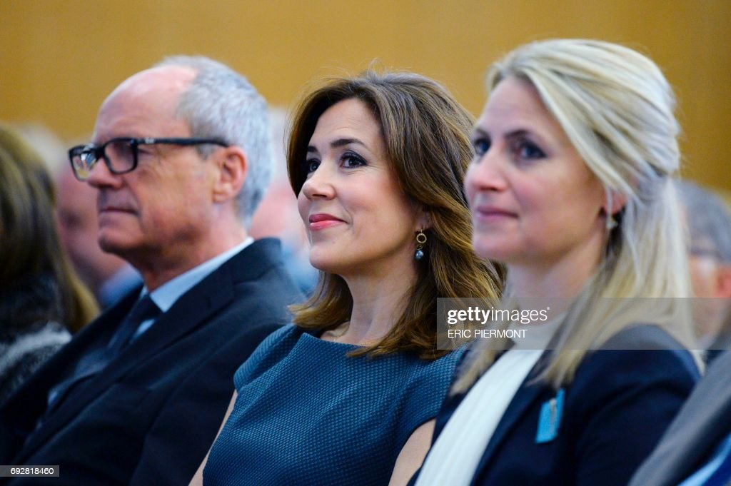 Danish Princess Mary (C) listens to OECD Secretary General's address while attending the OECD Forum 2017 opening on June 6, 2017 at the OECD headquarters in Paris. /