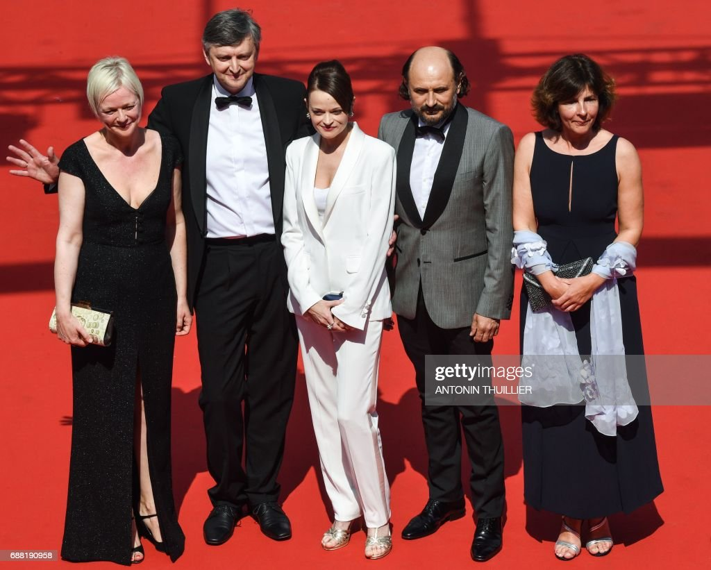 Danish producer Marianne Slot, Russian director Sergei Loznitsa, actress Vasilina Makovtseva, Moldovan actor Valeriu Andriuta and French producer Carine Leblanc pose as they arrive on May 25, 2017 for the screening of the film 'Krotkaya' (A Gentle Creature) at the 70th edition of the Cannes Film Festival in Cannes, southern France. / AFP PHOTO / Antonin THUILLIER