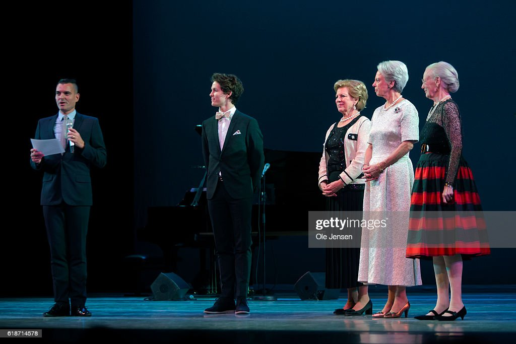 Danish Queen Margrethe (R) and her sisters, Princess Bennedikte (R, 2nd) and Queen Anne-Marie of Greece (R, 3rd) is on the stage to present late Queen Ingrid's grant to young artists, ballet dancer Andreas Kaas (C) during the Alvin Ailey's American Dance Theater performance in the Tivoli Concert Hall in Copenhagen on October 27, 2016 in Denmark. The award is given every second year to two young artists within dance and music. The other award winner this year was young jazz singer Sinne Eeg.