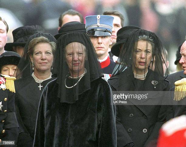 Danish Queen Margrethe center walks behind Danish Queen Mother Ingrid's coffin towards Copenhagen's central station during a ceremony at...