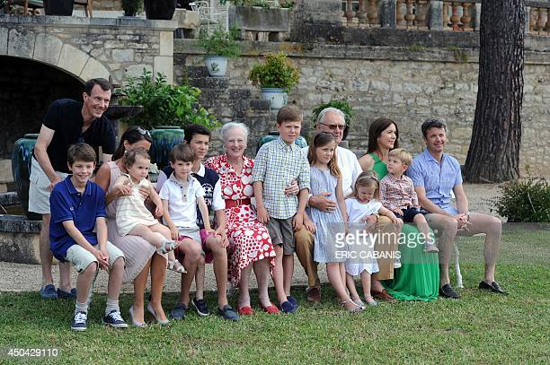 Danish Queen Margrethe II and Prince Henrik pose with some of their grandchildren on June 11 2014 2014 in the gardens of their chateau at Caïx The...