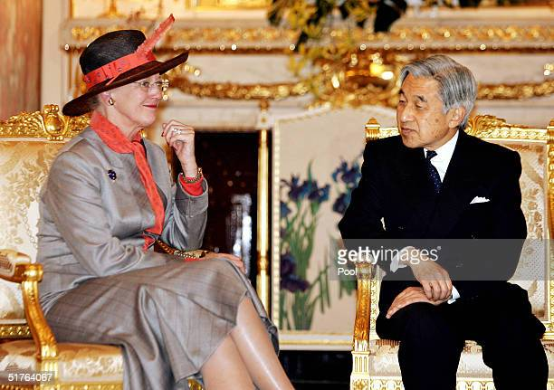 Danish Queen Margrethe II chats with Japanese Emperor Akihito as they bid farewell at the Akasaka Guesthouse November 19 2004 in Tokyo Japan Queen...