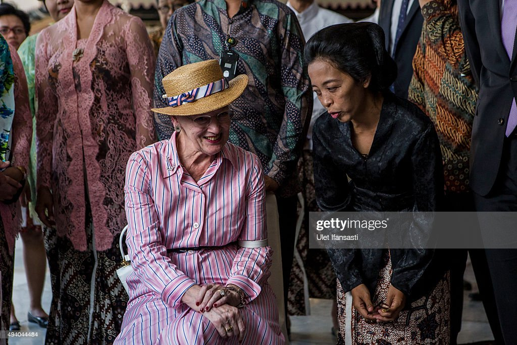 Danish Queen Margrethe II (L), listens as she watches the process of making batik during meets with Sri Sultan Hamengkubuwono X as her visit at Kraton Yogyakarta Palace on October 24, 2015 in Yogyakarta, Indonesia. Queen Margrethe II of Denmark and her husband, Prince Henrik, embarked upon a state visit to Indonesia to mark 65 years of diplomatic relations.