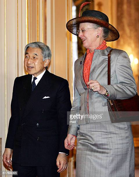 Danish Queen Margrethe II walks with Japanese Emperor Akihito as they bid farewell at the Akasaka Guesthouse on November 19 2004 in Tokyo Japan Queen...