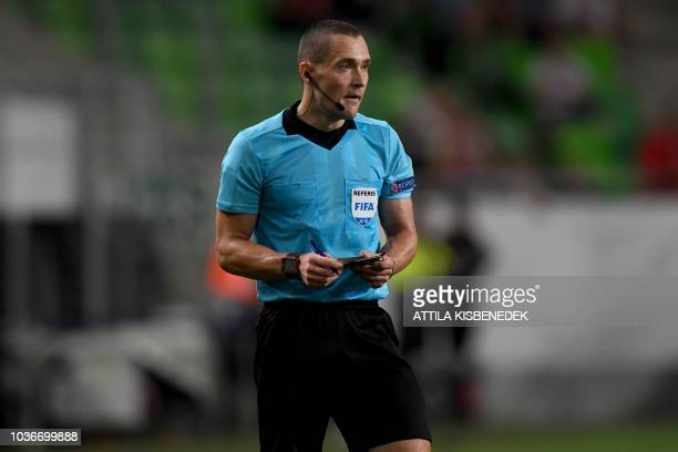 Danish referee MadsKristoffer Kristoffersen stands on the pitch during the UEFA Europa League football match between Vidi FC and FC BATE Borisov in...