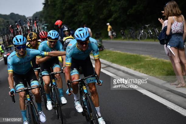 Danish rider Jakob Fuglsang rides as he bleeds after a fall in the first stage of the 106th edition of the Tour de France cycling race between...