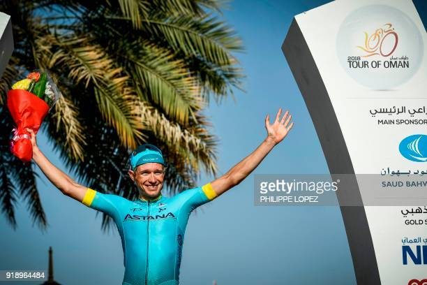 UCI Danish rider Magnus Cort Nielsen of the Astana team celebrates on the podium after winning the fourth stage of the cycling Tour of Oman between...