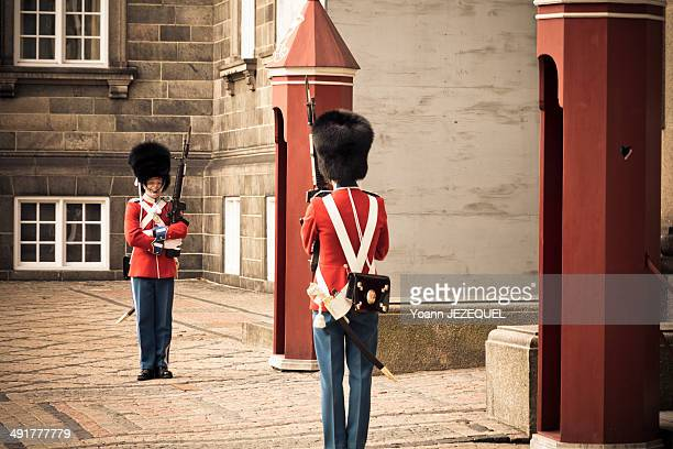 CONTENT] Danish royal guard in Copenhagen Military with guns protect the Christiansborg Palace