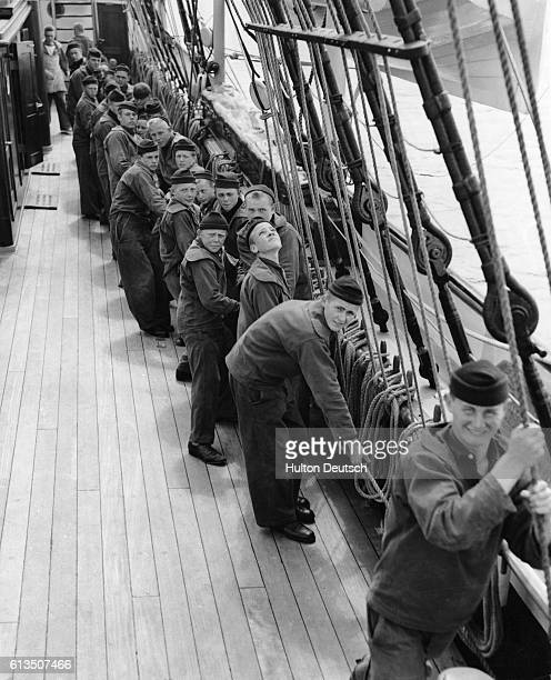 Danish sailors pull lines on the deck of the training ship Georg Stage They are preparing for an international yacht race