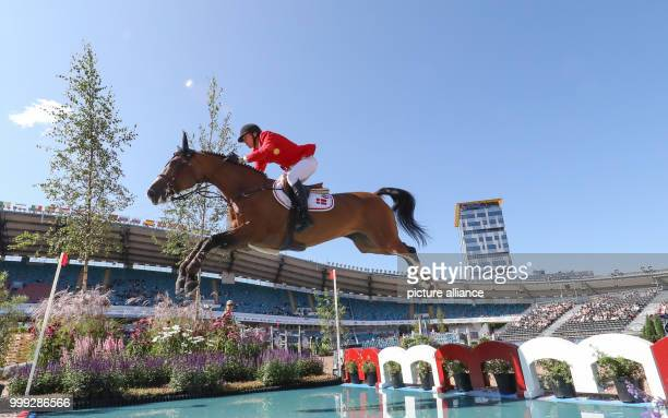 Danish show jumper Andreas Schou on his horse Hazel BS pictured jumping over a water obstacle during the show jumping contest of the FEI European...