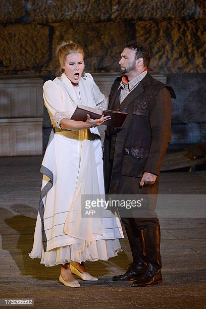Danish soprano Ann Peterson as Senta and German tenor Endrick Wottrichas Erik perform during a rehearsal of German composer Richard Wagner's opera...
