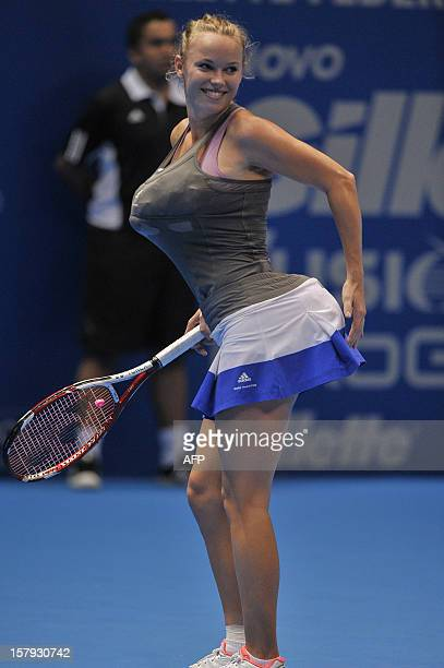 Danish tennis player Caroline Wozniacki impersonates Serena Williams by carrying towels under her clothes simulating bigger breasts and bottom during...