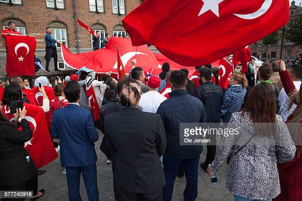 Danish Turks in solidarity demonstration for President Erdogan at Copenhagen City Hall Square Denmark on July 15 2016 The support rally was organized...