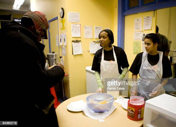 Danisia Anderson and Johanel Caceres volunteer at Broadway Community Inc to serve food prepared by the New York City Coalition Against Hunger during...