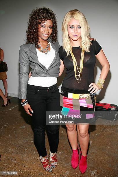 Danity Kane singers D Woods and Aubrey O'Day attend the Tory Burch Spring 2009 fashion show at the Matthew Marks Gallery on September 9 2008 in New...