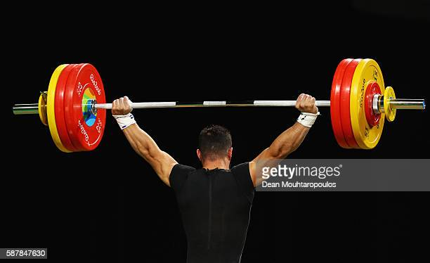 Daniyar Ismayilov of Turkey competes during the Men's 69kg Group A Weightlifting contest on Day 4 of the Rio 2016 Olympic Games at the Riocentro...