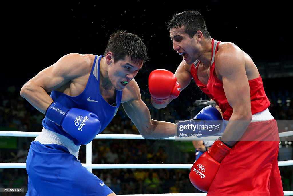 Daniyar Yeleussinov of Kazakhstan throws a left at Shakhram Giyasov of Uzbekistan in Men's Welterweight boxing during Day 12 of the Rio 2016 Olympic Games at Riocentro - Pavilion 6 on August 17, 2016 in Rio de Janeiro, Brazil.