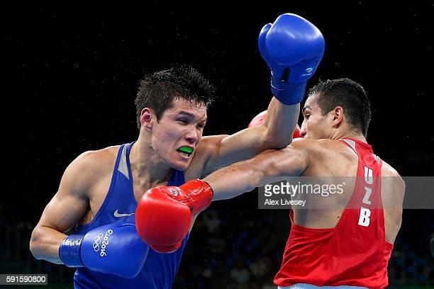 Daniyar Yeleussinov of Kazakhstan throws a left at Shakhram Giyasov of Uzbekistan in Men's Welterweight boxing during Day 12 of the Rio 2016 Olympic...