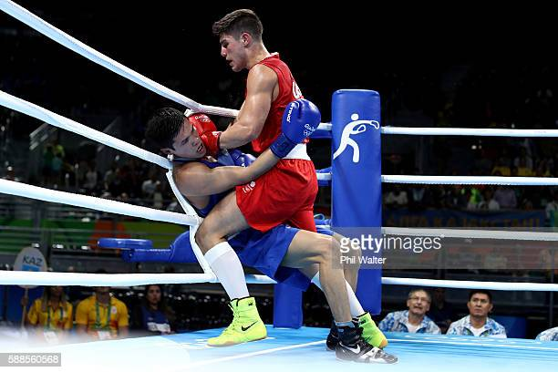 Daniyar Yeleussinov of Kazikstan fights Josh Kelly of Great Britain in their Mens Welterweight bout on Day 6 of the 2016 Rio Olympics at Riocentro -...