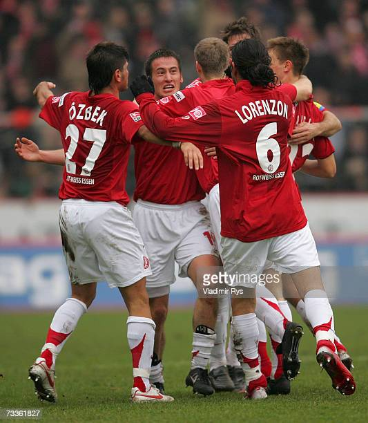 Danko Boskovic is congratulated by his team mates after scoring the second goal of Essen during the Second Bundesliga match between Rot Weiss Essen...
