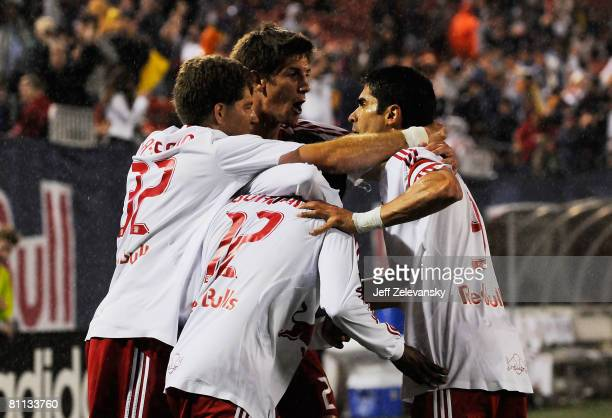 Danleigh Borman of the New York Red Bulls is mobbed by his teammates after scoring the game tying goal in the 81st minute against the Kansas City...
