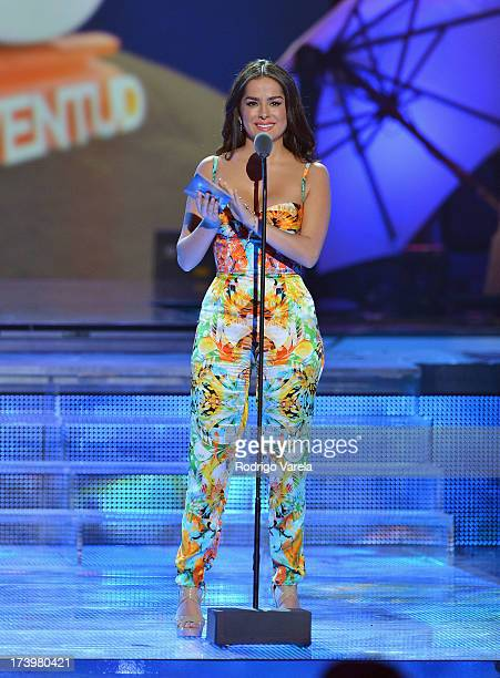 Danna Garcia speaks onstage during the Premios Juventud 2013 at Bank United Center on July 18 2013 in Miami Florida