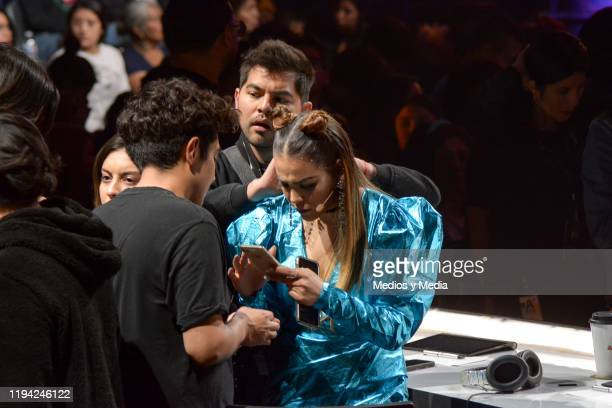Danna Paila checks her cels phone during the sixth concert of La Academia at Azteca Tlalpan on December 15 2019 in Mexico City Mexico