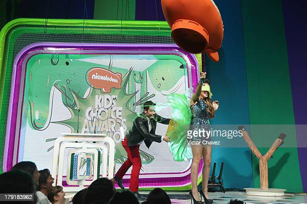 Danna Paola getting slimed onstage during the Kids Choice Awards Mexico 2013 at Pepsi Center WTC on August 31 2013 in Mexico City Mexico