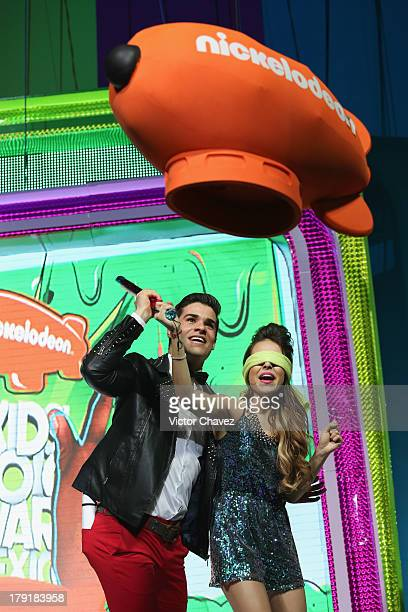 Danna Paola hits a piñata onstage during the Kids Choice Awards Mexico 2013 at Pepsi Center WTC on August 31 2013 in Mexico City Mexico
