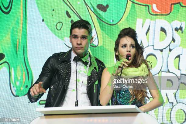 Danna Paola speaks onstage after getting slimed during the Kids Choice Awards Mexico 2013 at Pepsi Center WTC on August 31 2013 in Mexico City Mexico