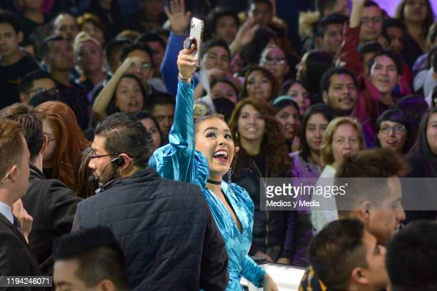 Danna Paola takes a selfie during the sixth concert of La Academia at Azteca Tlalpan on December 15 2019 in Mexico City Mexico