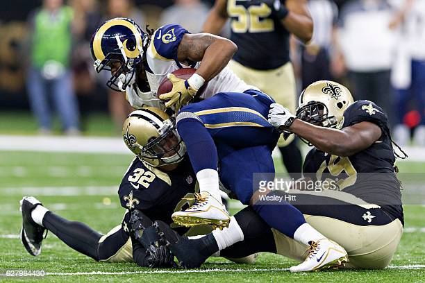 Dannell Ellerbe and Kenny Vaccaro of the New Orleans Saints tackles Todd Gurley of the Los Angeles Rams at MercedesBenz Superdome on November 27 2016...