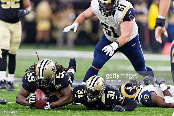 Dannell Ellerbe of the New Orleans Saints recovers a fumble by Brian Quick of the Los Angeles Rams at MercedesBenz Superdome on November 27 2016 in...