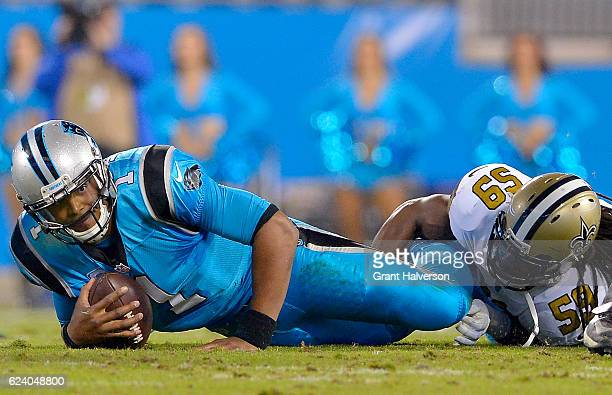 Dannell Ellerbe of the New Orleans Saints sacks Cam Newton of the Carolina Panthers in the 2nd quarter during the game at Bank of America Stadium on...