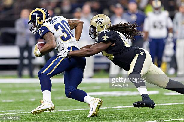 Dannell Ellerbe of the New Orleans Saints tackles Todd Gurley of the Los Angeles Rams at MercedesBenz Superdome on November 27 2016 in New Orleans...