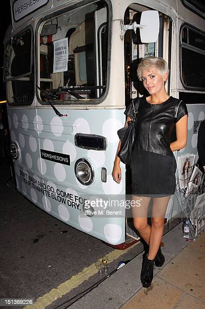 Danni Menzies attends the Hershesons' PopUp Blow Dry Bus as part of Vogue Fashion's Night Out on September 6 2012 in London England