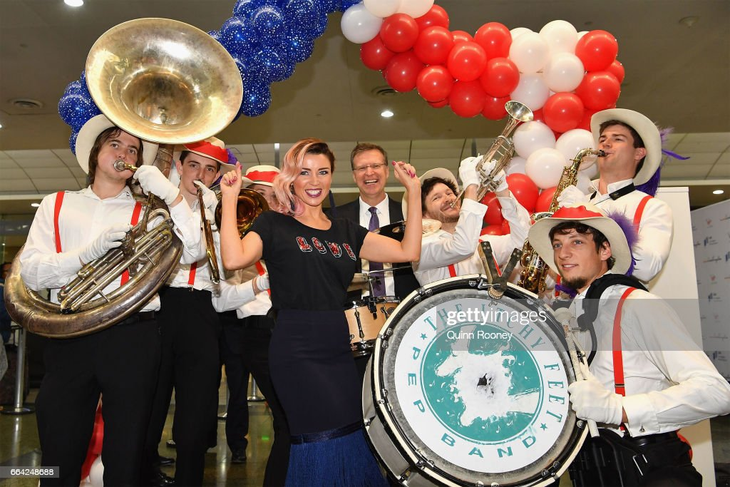 Danni Minogue poses with a marching band during a press conference announcing Virgin Australia's new Melbourne to Los Angeles flights on April 4, 2017 in Melbourne, Australia.