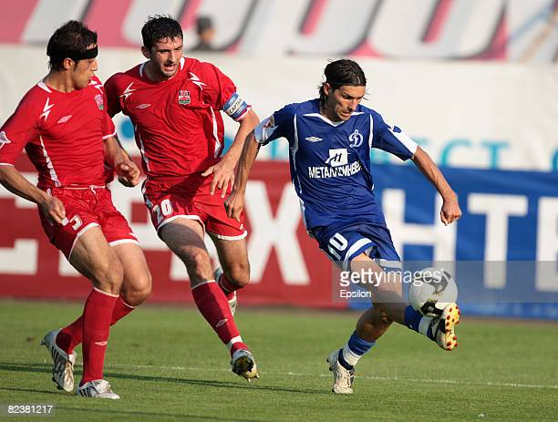 Danni of FC Dinamo Moscow competes for the ball with Alexandr Amisulashvili and Miodrag Dzhudovich of FC Spartak Nalchik during the Russian Football...