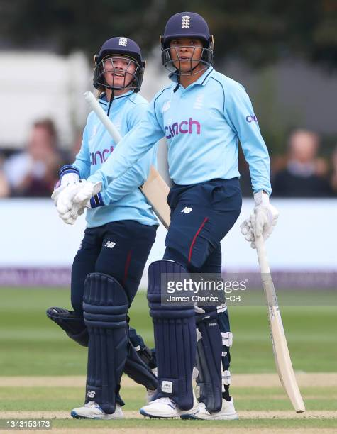 Danni Wyatt and Sophia Dunkley of England walk off after batting during the 5th One Day International match between England and New Zealand at The...