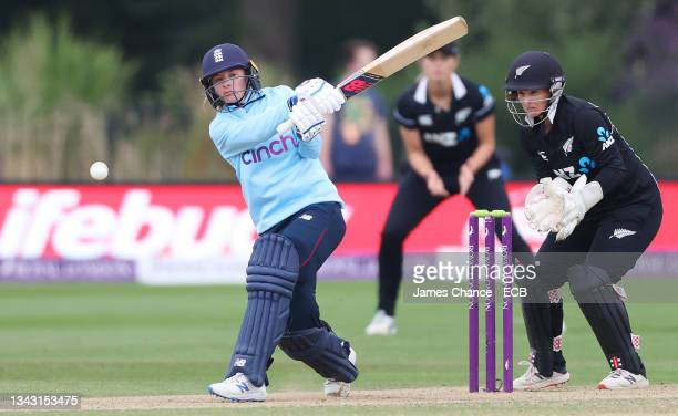 Danni Wyatt of England bats as Katey Martin, Wicketkeeper of New Zealand looks on during the 5th One Day International match between England and New...