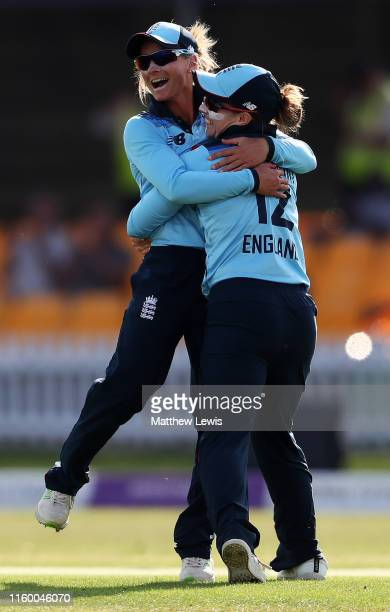 Danni Wyatt of England is congratulated after catching Alyssa Healy of Australia during the 2nd Royal London Women's ODI match between England and...