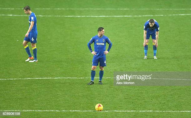 Dannie Bulman of AFC Wimbledon is dejected after his side go 1-0 down during the Sky Bet League One match between Milton Keynes Dons and AFC...