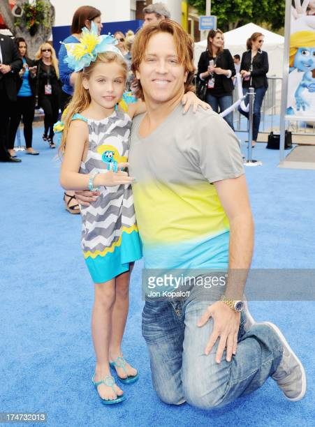 Dannielynn Birkhead and dad Larry Birkhead arrive at the Los Angeles Premiere Smurfs 2 at Regency Village Theatre on July 28 2013 in Westwood...